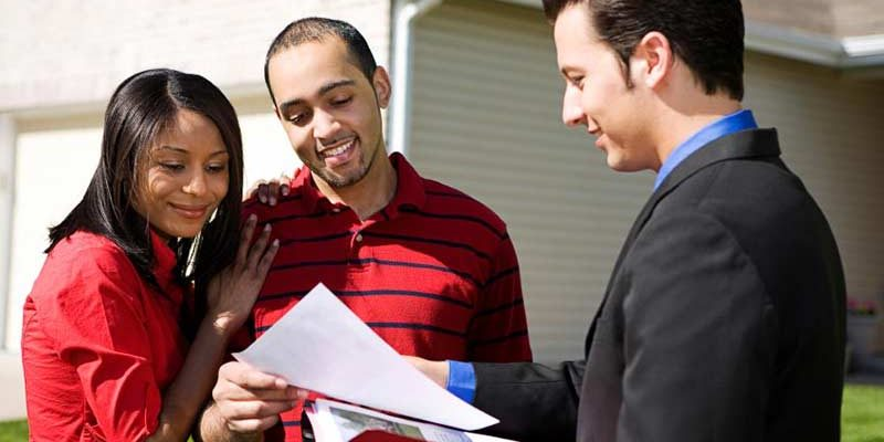 real estate agent with homebuyers